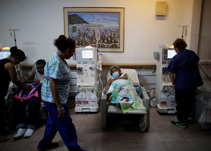 Lesbia Avila de Molina, 53, a kidney disease patient, reacts during a dialysis session at a dialysis center, after a blackout in Maracaibo, Venezuela. (Photo: Ueslei Marcelino/Reuters)
