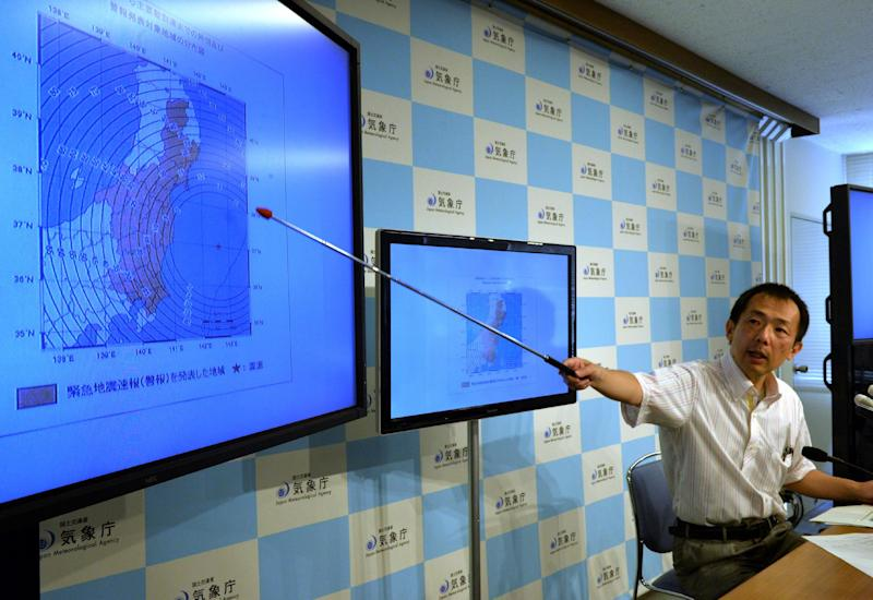Japan Meteorological Agency officer Yasuhiro Yoshida speaks at a press conference in Tokyo on July 12, 2014, after a strong 6.8 magnitude earthquake struck off the country's Pacific coast