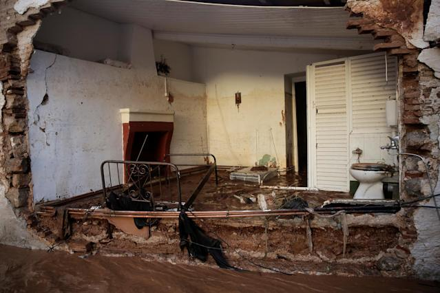 <p>Part of a destroyed house is seen following heavy rainfall in the town of Mandra, Greece, Nov. 15, 2017. (Photo: Alkis Konstantinidis/Reuters) </p>