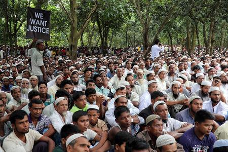 FILE PHOTO: Rohingya refugees take part in a protest at the Kutupalong refugee camp to mark the one year anniversary of their exodus in Cox's Bazar