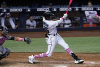 Miami Marlins right fielder Lewis Brinson (25) hits a solo home run in the seventh inning of a baseball game against the Milwaukee Brewers, Sunday, May 9, 2021, in Miami. (AP Photo/Marta Lavandier)