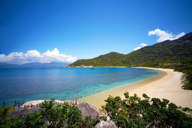 """<p>Many words come to mind when describing the setting of the <a rel=""""nofollow noopener"""" href=""""http://www.sixsenses.com/SixSensesNinhVanBay"""" target=""""_blank"""" data-ylk=""""slk:Six Senses Ninh Van Bay"""" class=""""link rapid-noclick-resp"""">Six Senses Ninh Van Bay</a>, but the most accurate would be 'surreal'. The setting is unparalleled and otherworldly–a painting come to life–in one of the more isolated and visually stunning settings in the world. </p><p>Incomparable and understated luxury typify this Six Senses haven, where you can enjoy sweeping views of the East Vietnam sea and it's lush hillsides. Take them in by boat, bike or private sunken pool (in your villa). Prepare for a trip that's more seaworthy than airborne–you can only access this area by boat and you will immediately feel as though you're slipping into seclusion during the journey to this property. The best way to take in all that this area has to offer is by candlelight dinner as you watch the sunset across the horizon.</p>"""
