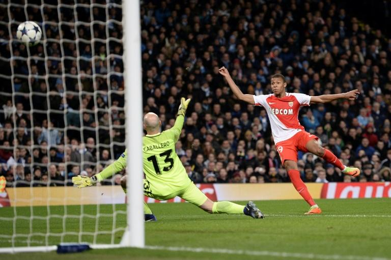 Monaco's Kylian Mbappe (R) scores a goal during their UEFA Champions League round of 16 1st leg match against Manchester City, at the Etihad Stadium in Manchester, on February 21, 2017