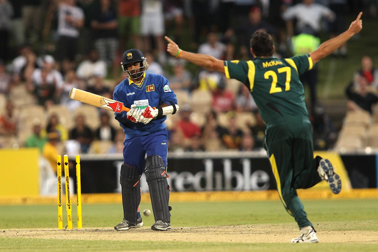 ADELAIDE, AUSTRALIA - MARCH 08: Clint McKay (R) of Australia celebrates after getting the wicket of Lasith Malinga (L) of Sri Lanka during the third One Day International Final series match between Australia and Sri Lanka at Adelaide Oval on March 8, 2012 in Adelaide, Australia.  (Photo by Morne de Klerk/Getty Images)