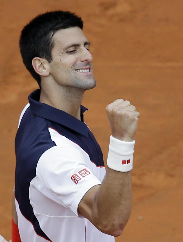 Serbia's Novak Djokovic celebrates at the end of his final match against Spain's Rafael Nadal, at the Italian open tennis tournament in Rome, Sunday, May 18, 2014. Novak Djokovic extended his recent dominance over Rafael Nadal by rallying for a 4-6, 6-3, 6-3 victory Sunday to win the Italian Open for the third time. (AP Photo/Gregorio Borgia)