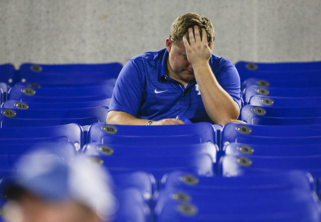 FILE - In this Sept. 23, 2017, file photo, Kentucky fan John Tribble sits in the stands after Florida defeated his team in an NCAA college football game in Lexington, Ky. No. 25 Florida (1-0) is seeking its 32nd consecutive victory against Kentucky (1-0) when the teams open Southeastern Conference play in the Swamp on Saturday. Its the longest active streak in an uninterrupted series and the fourth-longest in NCAA history. (AP Photo/David Stephenson, File)