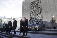 United States Vice President Mike Pence with his wife Karen, Prime Minister of Poland Mateusz Morawiecki with his wife Iwona and Israeli Prime Minister Benjamin Netanyahu with his wife Sara, from right, leave the Monument to the Ghetto Heroes during a wreath laying ceremony in Warsaw, Poland, Thursday, Feb. 14, 2019. The Polish capital is host for a two-day international conference on the Middle East, co-organized by Poland and the United States. (AP Photo/Michael Sohn)