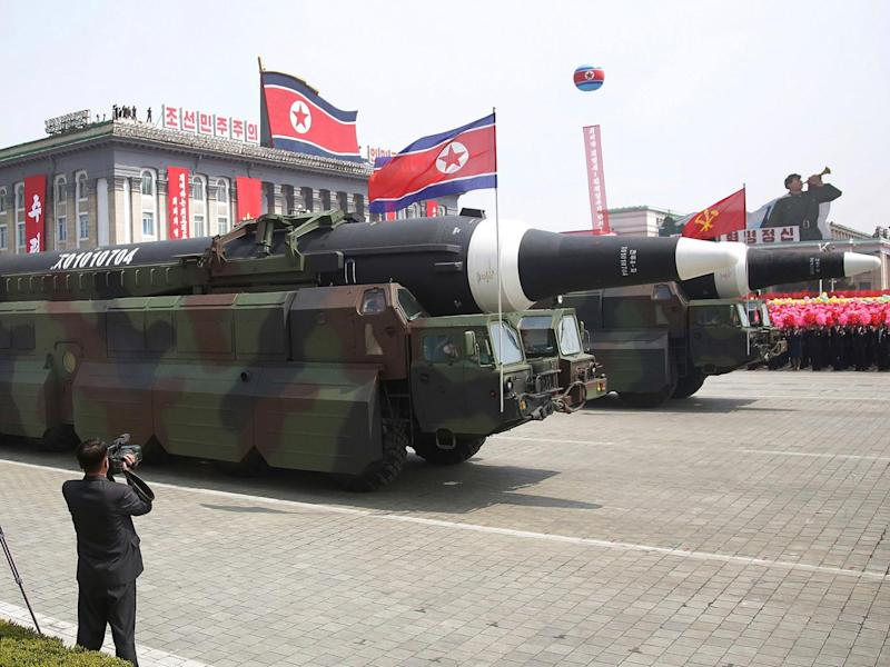 What military experts say appears to be a North Korean KN-08 inter-continental ballistic missile is paraded across Kim Il Sung Square during a military parade on 15 April (AP)