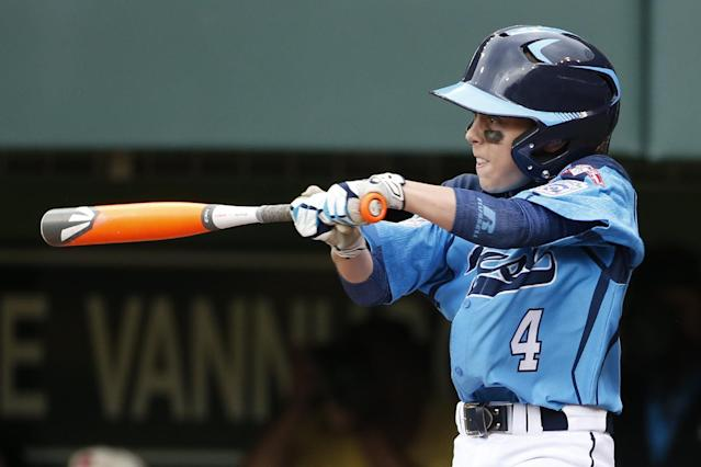 Las Vegas' Drew Laspaluto (4) drives in three runs with a double off Chicago's Joshua Houston in the first inning of a United States Championship game at the Little League World Series tournament in South Williamsport, Pa., Saturday, Aug. 23, 2014. (AP Photo/Gene J. Puskar)