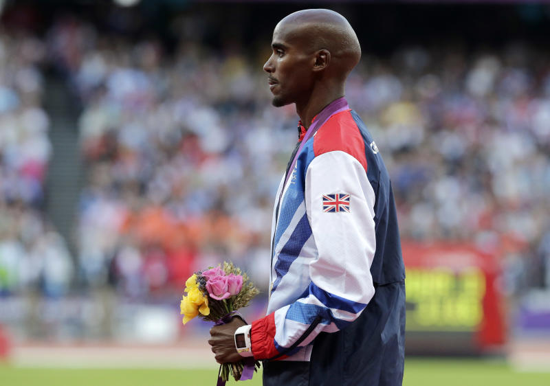 Britain's Mo Farah reacts after being presented with the gold medal in the men's 10,000 meters during the athletics in the Olympic Stadium at the 2012 Summer Olympics, London, Sunday, Aug. 5, 2012. (AP Photo/Luca Bruno)