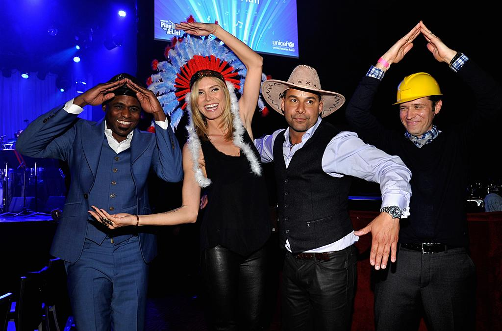 """No one is going to mistake them for the Village People, but comedian Wayne Brady, model/host Heidi Klum, and actors Jon Huertas and Seamus Dever did their best impression on Thursday night during the UNICEF Playlist With The A-List benefit at L.A.'s El Rey Theatre when Klum and friends did a karaoke rendition of the iconic hit """"YMCA."""" Even fellow celebs Tom Hanks and wife Rita Wilson got into the spirit, dancing along in the audience. Hanks wore the construction hat, while his wife opted to be the cowboy. (3/15/2012)"""