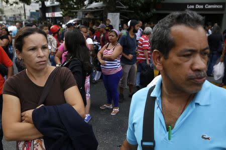 People try to find other modes of transportation after subway services were cut off during a blackout in Caracas June 27, 2014. REUTERS/Carlos Garcia Rawlins