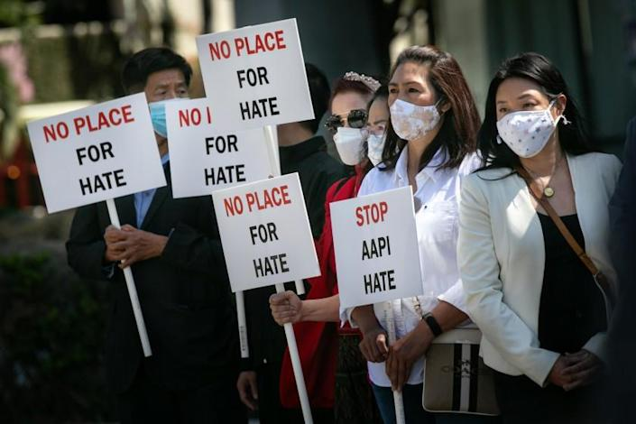 LOS ANGELES, CA - MARCH 22: Asian community members hold signs calling for hate to stop at news conference organized to take a unified stand opposing hate crimes against members of the Asian Pacific Islander community on Monday, March 22, 2021 in Los Angeles, CA. (Jason Armond / Los Angeles Times)