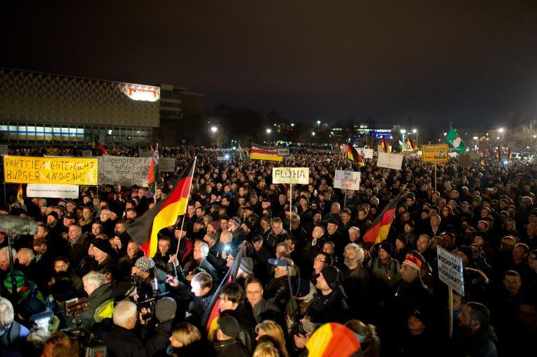 """Supporters of the """"Patriotische Europaeer Gegen die Islamisierung des Abendlandes"""" movement, which translates to """"Patriotic Europeans Against the Islamification of the Occident,"""" take part in a rally in Dresden, Germany on December 15, 2014"""