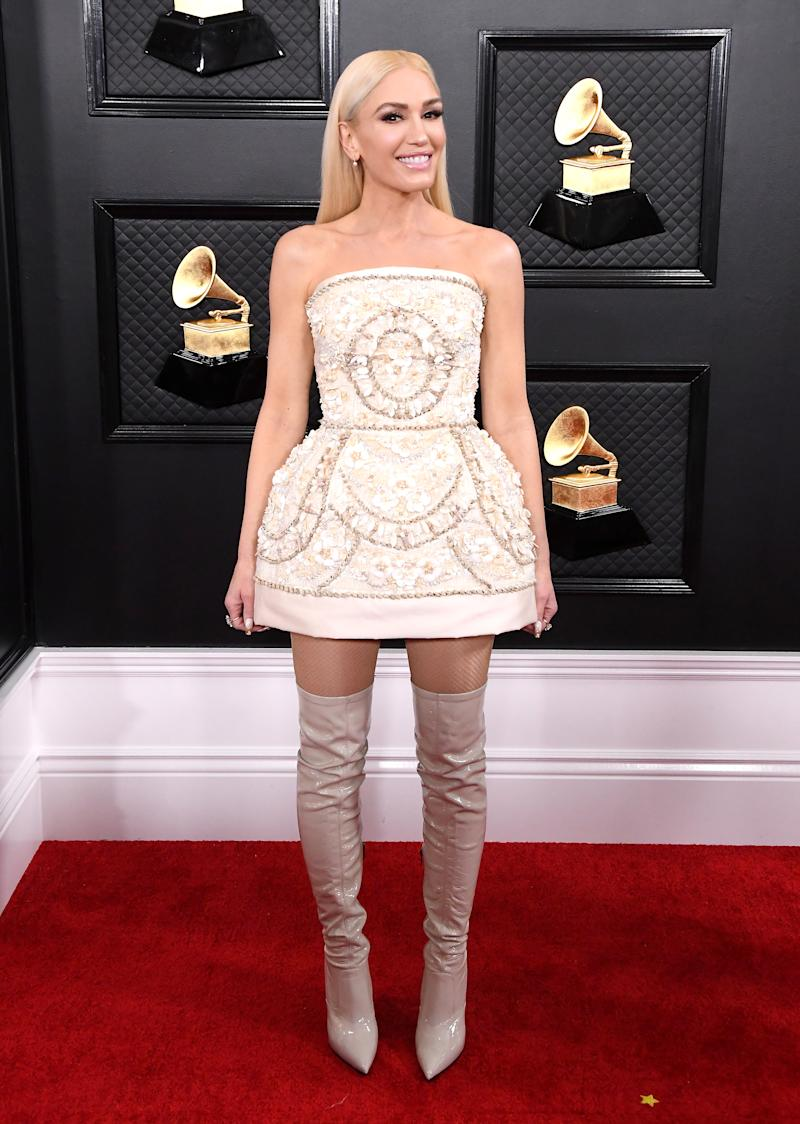 Gwen Stefani wears a structured dress decorated in shells on the Grammy's red carpet. (Photo: Getty Images)
