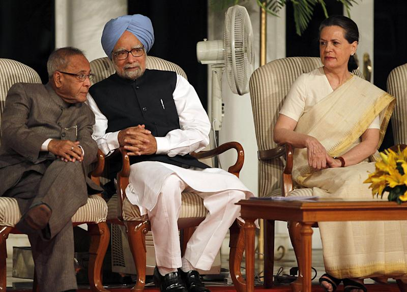 FILE - In this Tuesday, May 22, 2012 file photo, Indian Prime Minister Manmohan Singh, center, listens to Finance Minister Pranab Mukherjee, left, as Congress party President Sonia Gandhi sits beside them at a function to mark the completion of three years of the government in New Delhi, India. Mukherjee, who spent years whipping coalition partners into shape and quelling scandals as the Congress Party's chief firefighter, seems likely to leave all that behind and become India's figurehead president in an election Thursday, July 18, 2012. (AP Photo/Manish Swarup, File)