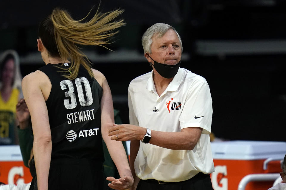 Seattle Storm head coach Dan Hughes looks toward the court in the first half of a WNBA basketball game against the Las Vegas Aces, Saturday, May 15, 2021, in Everett, Wash. (AP Photo/Elaine Thompson)