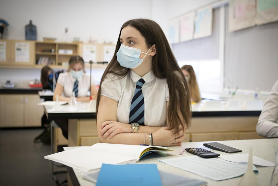 Secondary school pupils and teachers will still require to wear face masks, the First Minister said. (Jane Barlow/PA)