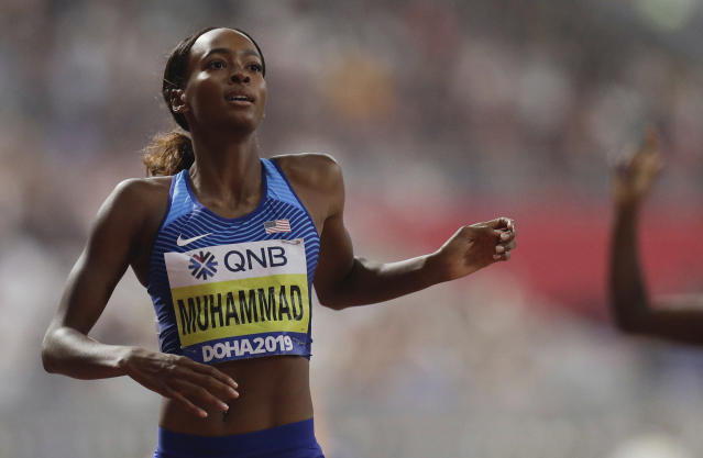 FILE - In this Oct. 4, 2019, file photo, Dalilah Muhammad, of the United States, wins the gold medal in the women's 400-meter hurdles final at the World Athletics Championships in Doha, Qatar. Pioneering marathon runner Eliud Kipchoge and hurdler Muhammad have been named the world athletes of the year in track and field. (AP Photo/Petr David Josek, File)