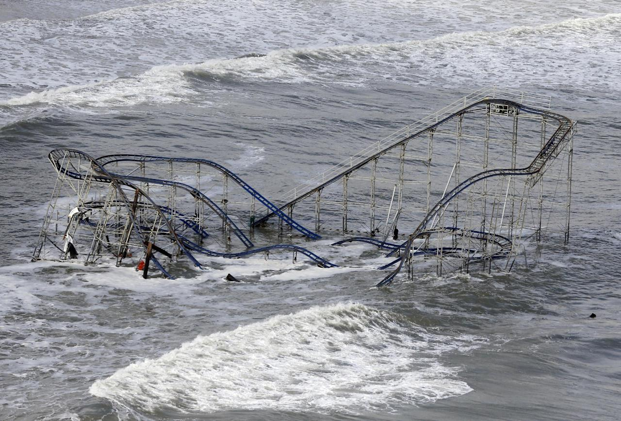 Waves wash over a roller coaster from a Seaside Heights, N.J. amusement park that fell in the Atlantic Ocean during superstorm Sandy on Wednesday, Oct. 31, 2012. New Jersey got the brunt of the massive storm, which made landfall in the state and killed six people. More than 2 million customers were without power as of Wednesday afternoon, down from a peak of 2.7 million. (AP Photo/Mike Groll)