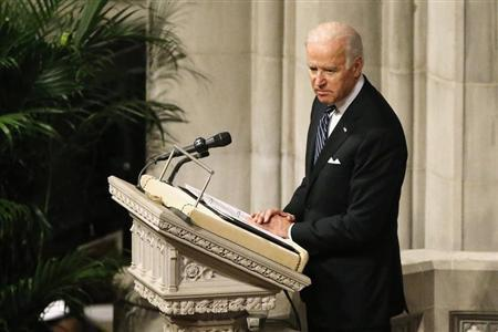 Biden delivers a tribute during the National Memorial Service for Nelson Mandela at the National Cathedral in Washington