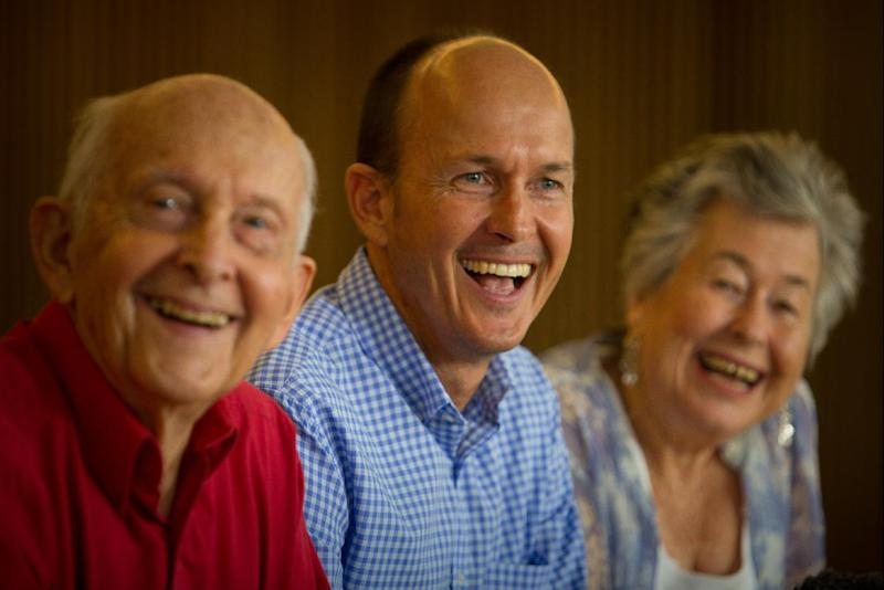 Juris Greste (L), father of Australian journalist Peter Greste, brother Andrew Greste and mother Lois Greste take part in a press conference in Brisbane on February 2, 2015, after Cairo deported the award-winning correspondent for Al-Jazeera (AFP Photo/Patrick Hamilton)