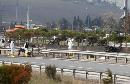 Forensic experts examine the scene after a helicopter crashed in Istanbu