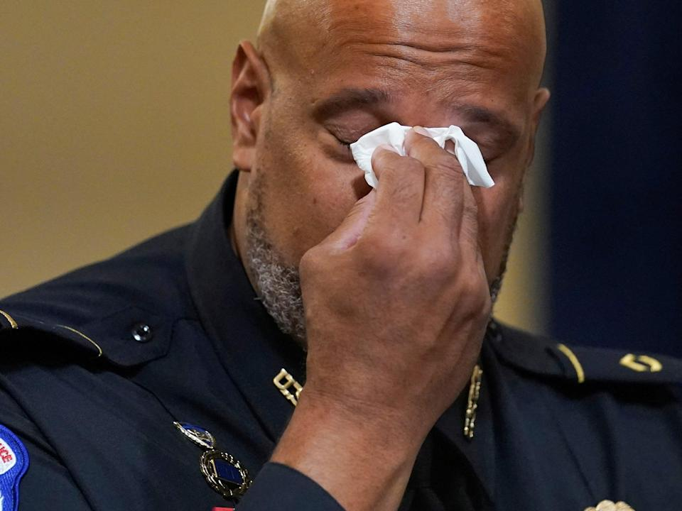 US Capitol Police Seargent Harry Dunn wipes his eyes during the House select committee hearing on the 6 January attack on Capitol Hill in Washington 27 July 2021 (REUTERS)