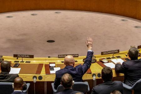 Russian Ambassador to the United Nations Vasily Nebenzya votes against a bid to renew an international inquiry into chemical weapons attacks in Syria, during a meeting of the U.N. Security Council at the United Nations headquarters in New York