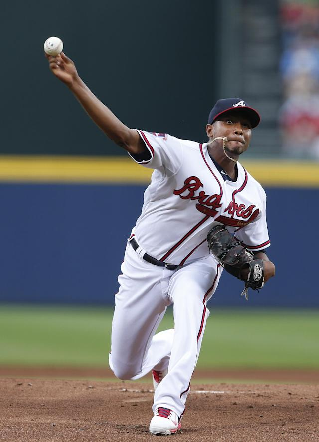 Atlanta Braves starting pitcher Julio Teheran (49) works in the first inning of a baseball game against theMiami Marlins in Atlanta, Monday, July 21, 2014. (AP Photo/John Bazemore)
