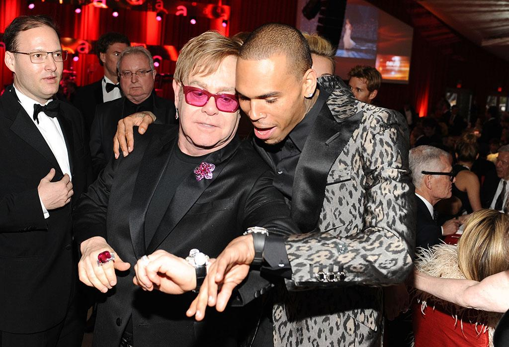 Sir Elton John and Chris Brown attend Chopard at 21st Annual Elton John AIDS Foundation Academy Awards Viewing Party at Pacific Design Center on February 24, 2013 in West Hollywood, California.