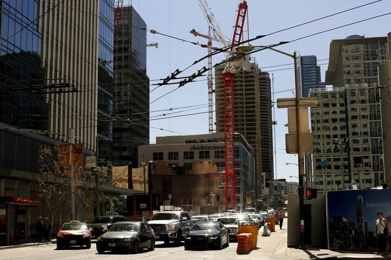 Cars wait for traffic near a residential construction project in downtown San Francisco