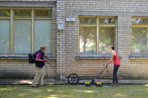 Harry Jol and Nicole Awad conduct a ground-penetrating radar survey at the site of the Great Synagogue of Vilna in Lithuania.