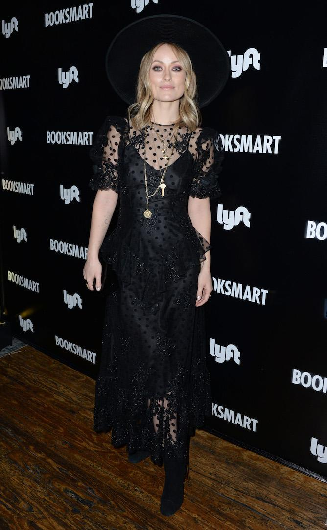 <p>On March 10, actress Olivia Wilde wore a lace black dress and co-ordinating hat for a starry photocall.<em>[Photo: Getty]</em> </p>