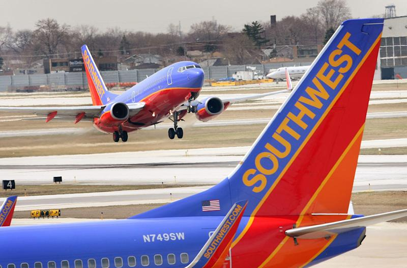 An unidentified couple aboard a Southwest Airlines flight who engaged in a sexual act mid-flight was questioned by local authorities upon landing but will not face charges. In this photo, A Southwest Airlines jet takes off at Midway Airport April 3, 2008 in Chicago, Illinois.