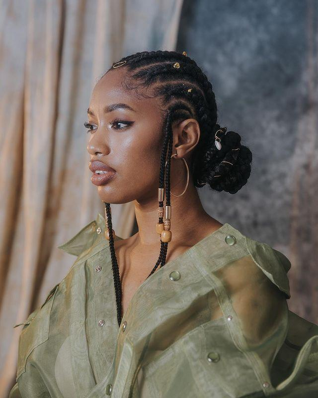 """<p>This Fulani braided bun will keep your hair off your back and tucked away for 100% protective styling.</p><p><a href=""""https://www.instagram.com/p/CCb_pTdHQLc/"""" rel=""""nofollow noopener"""" target=""""_blank"""" data-ylk=""""slk:See the original post on Instagram"""" class=""""link rapid-noclick-resp"""">See the original post on Instagram</a></p>"""
