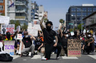 Demonstrators kneel in a moment of silence outside the Long Beach Police Department on Sunday, May 31, 2020, in Long Beach during a protest over the death of George Floyd. Protests were held in U.S. cities over the death of Floyd, a black man who died after being restrained by Minneapolis police officers on May 25. (AP Photo/Ashley Landis)