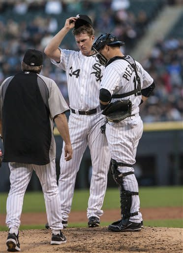 Chicago White Sox pitcher Gavin Floyd waits for pitching coach Don Cooper during the Minnesota Twins' four-run second inning during a baseball game in Chicago on Tuesday, May 22, 2012. At right is catcher A.J. Pierzynski. (AP Photo/Charles Cherney)