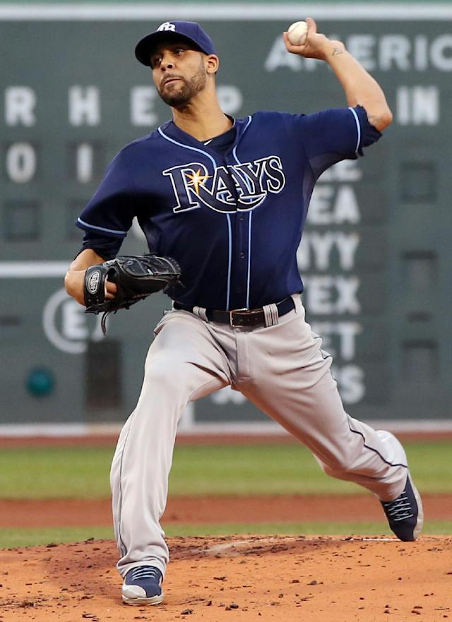 Tampa Bay Rays starting pitcher David Price delivers to the Boston Red Sox during the first inning of a baseball game at Fenway Park in Boston on Wednesday, July 24, 2013. (AP Photo/Elise Amendola)