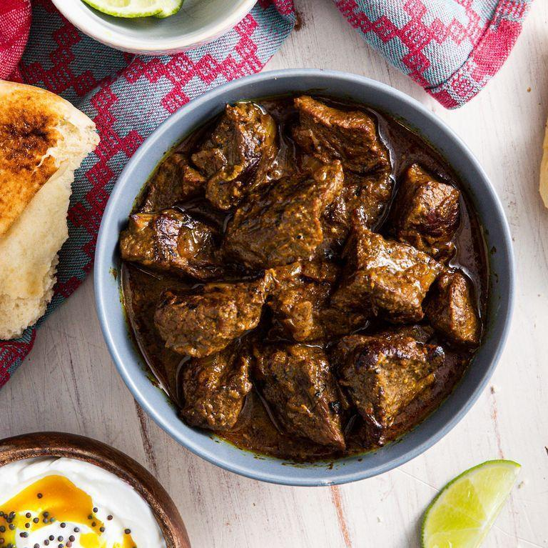 """<p>Braising the beef in the coconut milk and spice mixture allows all of the flavours to mingle — resulting in an amazingly flavourful curry. </p><p>Get the <a href=""""https://www.delish.com/uk/cooking/recipes/a31149870/beef-curry-recipe/"""" rel=""""nofollow noopener"""" target=""""_blank"""" data-ylk=""""slk:Beef Curry"""" class=""""link rapid-noclick-resp"""">Beef Curry</a> recipe.</p>"""