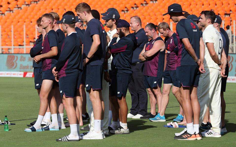 England's players watch on as India are presented with the trophy - AP