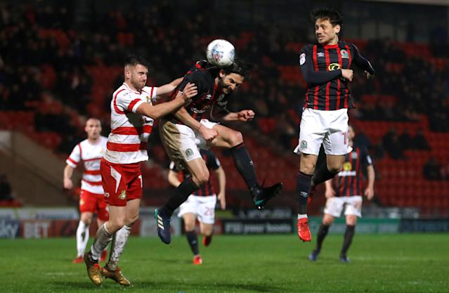 """Soccer Football - League One - Doncaster Rovers v Blackburn Rovers - Keepmoat Stadium, Doncaster, Britain - April 24, 2018 Blackburn Rovers' Charlie Mulgrew scores their first goal Action Images/Lee Smith EDITORIAL USE ONLY. No use with unauthorized audio, video, data, fixture lists, club/league logos or """"live"""" services. Online in-match use limited to 75 images, no video emulation. No use in betting, games or single club/league/player publications. Please contact your account representative for further details."""