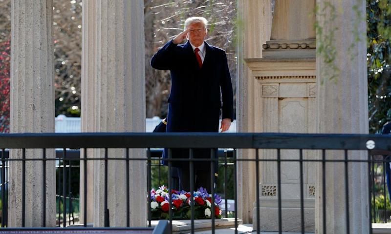 Donald Trump salutes after laying a wreath at the Hermitage, the home of Andrew Jackson, in Nashville, Tennessee.