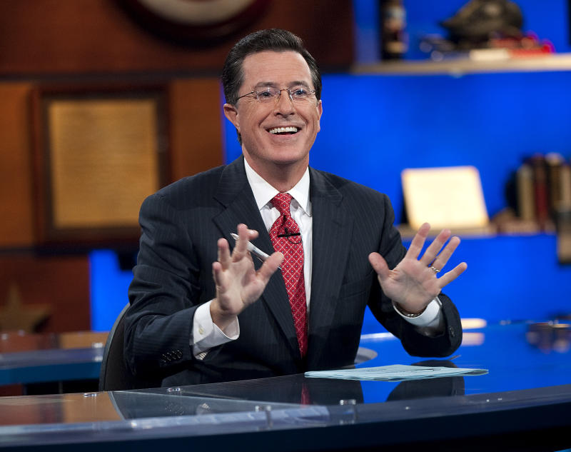 """This Sept. 8, 2010 publicity photo released by Comedy Central shows host Stephen Colbert appears on """"The Colbert Report,"""" in New York. Colbert's """"song of the summer"""" special was either a real-life corporate tiff over Daft Punk or the most elaborately-planned _ and funniest _ corporate cross-promotions in memory. On his Comedy Central show Tuesday, Aug. 6, 2013, Colbert said he had Daft Punk booked to perform the hit """"Get Lucky"""" that night. But he said that on the day before, fellow Viacom Inc., network MTV had pulled rank, claiming the French dance duo had agreed to perform at the Video Music Awards on Aug. 25 and make the show its exclusive U.S. TV appearance. (AP Photo/Comedy Central, Scott Gries)"""