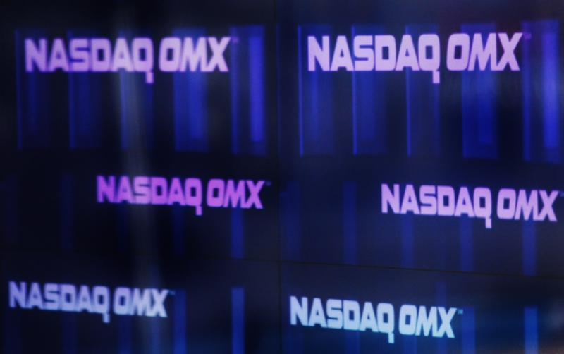 Nasdaq OMX signs are seen inside their studios at Times Square in New York