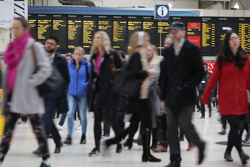 Commuters arrive at Victoria station on their way to work in central London on March 23, 2017. Seven people have been arrested including in London and Birmingham over Wednesday's terror attack at the British parliament, the police said today, revising down the number of victims to three people. / AFP PHOTO / Daniel LEAL-OLIVAS (Photo credit should read DANIEL LEAL-OLIVAS/AFP/Getty Images)