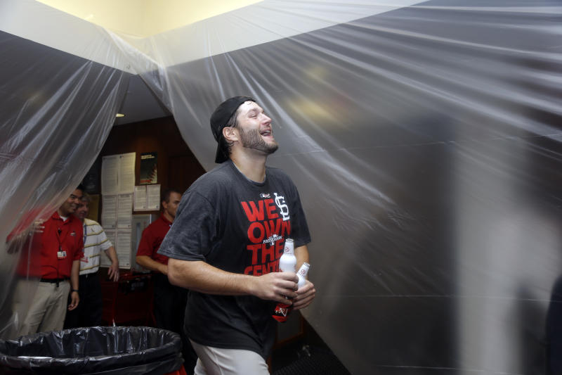 St. Louis Cardinals starting pitcher Lance Lynn celebrates after the Cardinals' 7-0 win over the Chicago Cubs in a baseball game Friday, Sept. 27, 2013, in St. Louis. The Cardinals clinched the NL Central title. (AP Photo/Jeff Roberson)