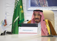 In this handout image provided by Saudi Royal Palace, Saudi King Salman gives his opening remarks at a virtual G20 summit hosted by Saudi Arabia and held over video conference amid the COVID-19 pandemic, in Riyadh, Saudi Arabia, Saturday, Nov. 21, 2020. (Bandar Aljaloud/Saudi Royal Palace via AP)