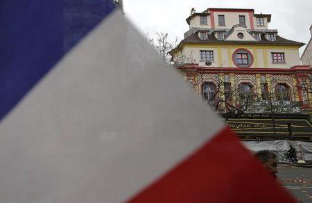 A French flag is seen in front of the Bataclan concert hall to pay tribute to the victims of the series of deadly attacks in Paris