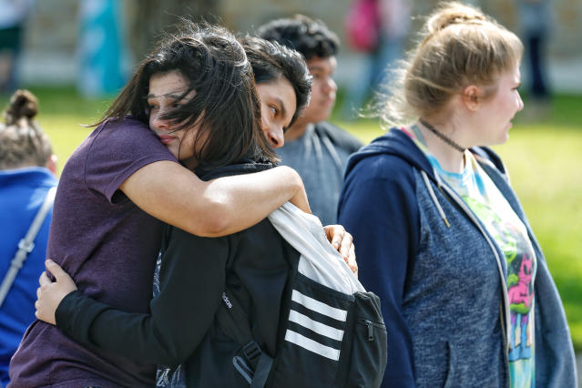 <p>Santa Fe High School freshman Caitlyn Girouard, center, hugs her friend outside the Alamo Gym where students and parents wait to reunite following a shooting at Santa Fe High School Friday, May 18, 2018, in Santa Fe, Texas. (Photo: Michael Ciaglo/Houston Chronicle via AP) </p>